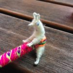 An alpaca humping a pencil